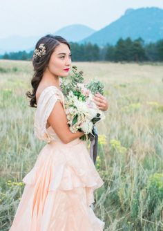 There are bridal shoots and then there are bridal shoots set on a stunning mountaintop. The latter is what we've got sitting pretty just below. Beautifully captured by Jennifer Blair, this shoot is out to prove all it takes is a bride, a bouquet