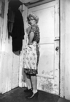 cindy sherman. THIS is the first photo by cindy sherman that i ever saw. my professor pointed out the clicker under her show and from then on i tried to find it in every shot. something about this shot is so rosie the riveter yet has an abused and grimy feel to it.