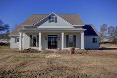 Custom Antoinette floor plan with Americana elevation-- Manuel Builders