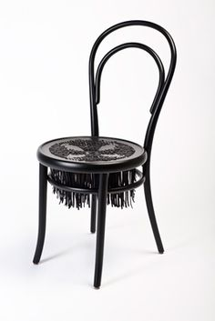 black woven chair by sam baron and fabrica, which were invited to customize the classic thonet no. 14