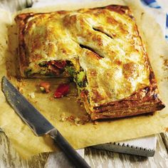 Crispy puff pastry encases roast vegetables and houmous in this easy-to-make pie - minus the egg yolk and milk for the vegan version