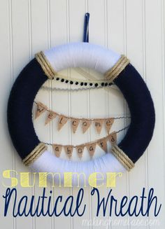 Hello Summer! Summer Nautical Wreath | The one I made has a red and white bow to hang it and an anchor in the center instead of the pennants.