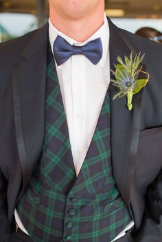 Scottish themed wedding with plaid inspired groom. Image Credits Thompson Photography Group.