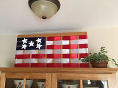 upcycled gate turned american flag Diy Dog Gate, Vintage Milk Can, Light Up Canvas, Pallet Flag, Wire Wreath Forms, Globe Decor, Old Sewing Machines, Wooden Gates, Diy Plant Stand