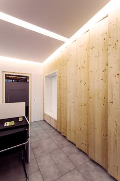 Law Firm Office in Milan by +R / www.piuerre.com / photo by Alberto Canepa / www.albertocanepa.com / #wood #custom #furniture #cupboard #zigzag #boiserie #interior #reception #lighting