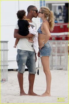 Interracial couple with biracial child. Model Doutzen Kroesand & husband DJSunnery James with their child.