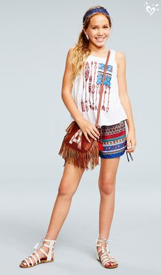 A-Plus style in a crossbody initial bag trimmed with fringe.