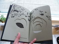 rather like the hole book you made (with my help) age about 5.....Bruno Munari - Nella Notte Buia - Perimeter Books