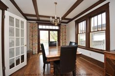 Dining room with wood trim and ceiling beams