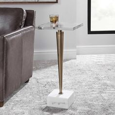 Style and sophistication.⠀ Let the Campeiro Drink Table speaks for itself.⠀ A thick crystal top on a tapered stainless steel base plated in brushed brass, resting on a natural white marble foot.⠀ @uttermostcompany⠀ Available in-store and for pick up!  #drinktable #accenttable #uttermostdesign #uttermostcompany #endtable #table #livingroom #lounge #sophisticated #design #interior4all #finedesign #interiordesign #interiorstyling #lovedesign #homedecor #interiordesigners #interiordecor…