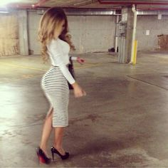 Pencil skirt white & black, white crop long sleeve top, black heels, black purse, curly hair