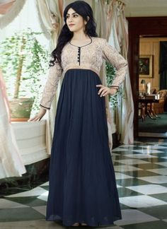 Fashionable navy blue faux georgette long gown which is ornamented with a self printed work on the sleeves and yoke part. This readymade gown has maximum bust size of 36 to 42 inches. Party Wear Gowns Online, Evening Gowns Online, Party Wear Dresses, Wedding Dresses For Girls, Indian Wedding Outfits, Indowestern Gowns, Printed Gowns, Floral Gown, Designer Gowns