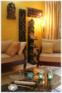 Eclectic corner created using wooden carvings and brass