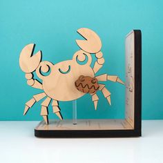 Hey, I found this really awesome Etsy listing at http://www.etsy.com/listing/106755927/wood-crab-bookend-kids-wooden-ocean-fish