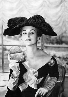 Monique Chevalier in evening dress by Lanvin-Castillo, black velvet hat adorned with ostrich feather by Legroux, jewellry and minaudier by (Pierre) Sterlé, photo by Georges Saad, 1956