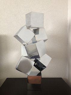 """Balanze Chromed"" - Chromed Steeel. Copyright © Tania Esponda Aja  #art #artist #sculpture #chrome #cubes #artist #reflection Geometric Sculpture, Abstract Sculpture, Sculpture Art, Paper Architecture, Concept Architecture, 3d Hand Drawings, Constructivism Architecture, Cube Design, Cardboard Art"