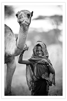 Photo by David Duchemin Ethiopia. Oh look, the camel is smiling, too!!! Cute!