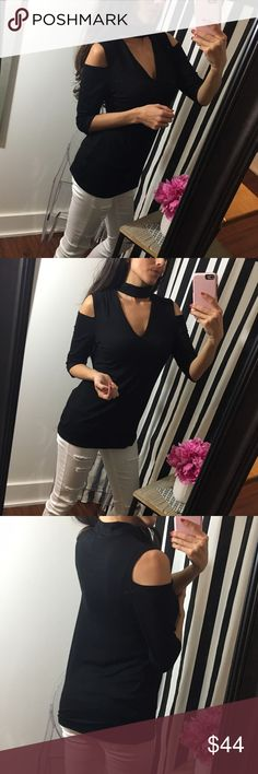 """Perfect Black Cold Shoulder Choker Top 🌟Buttery soft fabric and so classy and sexy! Choker neck and cold shoulder combine to make this one of the hottest pieces in your closet.🌟  I love the thickness of the choker and how the v-neck is just deep enough. Pair with skinny jeans and heels or dress down with wedges. Tuck it in for a tighter, body suit type fit.   ✨Also available in Navy blue in separate listing✨  Modeling a Medium (I am 5'2, 34B) Pit to pit 15.5""""in Shoulder to bottom hem 25""""in…"""