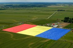 The largest flag in the world is Romanian. This is from 14 hours ago. An aerial picture shows the huge flag on the Clinceni airfield, south of Bucharest. Europe News, Central Europe, Top Stories Today, Happy National Day, Native Country, Putrajaya, Guinness World, Thinking Day, Largest Countries