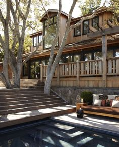 House is not my favorite, but I love the way the deck is built around the trees. And the nice couch next to the pool.