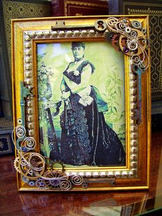 Steampunk/Victorian 5 x 7 Frame (F4) - Embellished Picture Frame - Gears and Coiled Wire - Swarovski Crystals. $39.00, via Etsy.