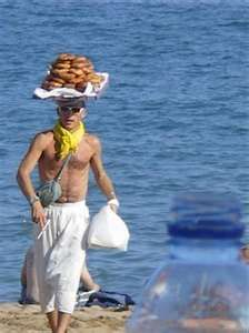 """DONUT MAN in Barceloneta. This guy is so famous in Barcelona's summers that he actually participated in Shakira's video """"Loca"""", recorded at Barceloneta beach. Travel Articles, Travel Photos, Barceloneta Beach, Barcelona, Spain Holidays, In The Hole, Travelogue, Free Travel"""