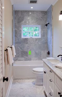 Small Bathroom Design Ideas Blending Functionality and Style Narrow bathroom benefits from shower window to break up the space and provide fresh air.Narrow bathroom benefits from shower window to break up the space and provide fresh air. Bathroom Tub Shower, Window In Shower, Bathroom Beach, Budget Bathroom, Bathroom Ideas On A Budget Small, Laundry Bathroom Combo, Shower Doors, Laundry Rooms, Bath Window