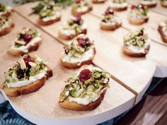 Charred Brussels Sprouts Crostini : Giada's crispy, smoky sprouts and cranberries plumped in Champagne vinegar add bite to creamy ricotta spread on toasts.