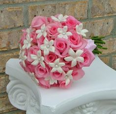 Bridal bouquet. Hand-tied wedding bouquet with pink roses and pearl-studded stephanotis. Pretty in pink.