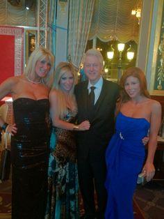 Bill Clinton posing with porn stars in Monaco.