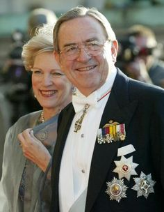 Former King Constantine of Greece and his wife Queen Anne Marie pass press photographers on their way to the Royal Theater in Copenhagen on 13  May  2004