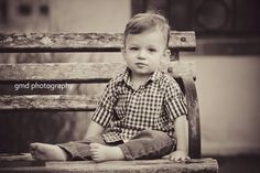 18 month old boy sitting on a bench