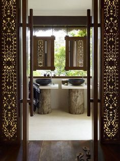 Gorgeous bathroom entrance with carved wood - everything symmetrical, carefully placed
