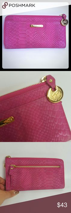 "GiGi NY PHONE WALLET Magenta Embossed Python Condition 9 /10, minimal amount of scuffs around the wallet from normal wear. The ultimate wallet, with a place for everything inside including your cell phone. Full-Grain Embossed Python Leather Two-sided zip-around closure with roomy interior Six credit card slots, two bill pockets and interior cell phone pocket Fits iPhone 6, 5, 5s, 5c and Samsung Galaxy S4, and S5 Exterior zip pocket for change Size: 7"" W ""x 4"" H GiGi New York Bags Wallets"