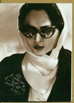 Rekha wearing cat eye glasses.