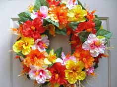 Hawaiian Luau Wreath, Tropical Luau Decor, Beach Pool Party Decoration, Hibiscus Wreath, Orange Pink and Yellow Hawaiian Flower, Outdoor Wreath, Summer Wreath  You can almost hear the ocean waves and the music of the ukulele when you see this Tropical Luau Wreath on your door! It would be a great summer addition to your home, office, beach, pool or luau party!  We constructed the wreath on a 14 straw base. Orange, pink, red and yellow double hibiscus blossoms fill out the wreath. Wild, spiky…
