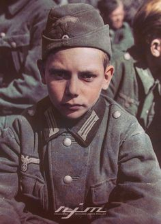 This 13 yr old German boy was one of 60 members of the Hitler Youth captured by the 14th Armoured Division, 3rd US Army, in the vicinity of Martinszell-Waltenhofen, Germany on April 29, 1945. The group of youngsters ranged in age from 13-17 yrs old. US Army Signal Corps photo- PFC Joseph W. Lapine Colourised by Colour by RJM