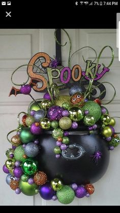 This is a perfect mash of holiday decorations - Christmas ornaments (I assume) with Halloween ornaments. Witch Cauldron Door Hanger -- made by Kathie Whiting (Halloween Casa Halloween, Theme Halloween, Halloween 2014, Diy Halloween Decorations, Holidays Halloween, Halloween Crafts, Happy Halloween, Halloween Door Wreaths, Halloween Deco Mesh