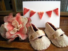 Cute little babies' shoe made with felt and wool.