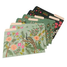 Being organized never looked so good! These vibrant, floral- and avian-themed file folders, with gold-foil accents and sticker labels, are too pretty to hide in your file drawers. Use them to keep bills, correspondence, meeting notes, or other loose papers tidy and sorted on your desk or kitchen counter. We're offering a set of six letter-sized folders (two each of three designs), for all of your organizing and record-keeping needs.