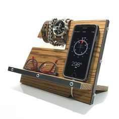 Industrial Style Wood & Steel iPhone Docking Station / Phone Organizer Features: Premium quality 1/2 thick White Oak wood construction with steel accents. The pictured piece has a beautiful Black Walnut Danish Oil finish, along with a top coat of natural finishing wax which has been