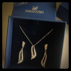 ✨✨Swarovski Pave Swoop Necklace And Earrings Set✨✨ Very classic. In a great condition. This can be a fantastic gift for someone or for yourself! :-)        Swarovski's chic asymmetrical drop pendant highlights clear crystal pave set in silver tone mixed metal. Approximate length: 15 1/2 inches. Approximate drop: 1 1/2 inches.  Box is included! 🎶  Price is firm. Jewelry Earrings
