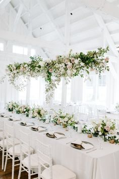 Wild greenery and rose hanging centerpiece Hanging Flowers Wedding, Hanging Flower Arrangements, Hanging Centerpiece, Wedding Reception Flowers, Wedding Flower Arrangements, Floral Wedding, Tall Centerpiece Wedding, Neutral Wedding Decor, Hanging Wedding Decorations
