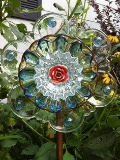 Deeply Scalloped Vintage Clear, Crystal, Glass, Gold and Blue Garden Yard Art Flower, Totem, Suncatcher, Garden Gift, Decoration. $35.00, via Etsy.