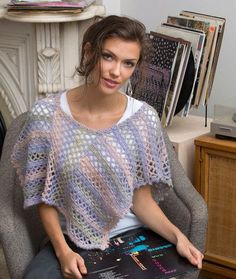 Shortly Oversized Poncho Pattern - This simple crochet poncho pattern is made of two rectangles that are joined together, allowing you to work up a simple design.