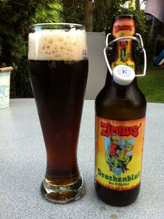 """A dark, """"dragon's blood"""" beer, based on the old Frankish recipe of the beer the knights drink in the German comic books of Zimbus von Döllnitz. Brewed by St. Georgenbräu Kramer in Buttenheim (www.kellerbier.de), this beer is more than just a beer: it's a collector's item!"""