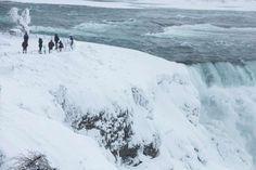 Visitors view Niagara Falls in sub freezing temperatures in Niagara Falls New York - Provided by Reuters