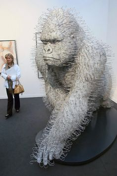 David Mach, a sculptor and installation artist, creates art entirely from wire coat hangers.