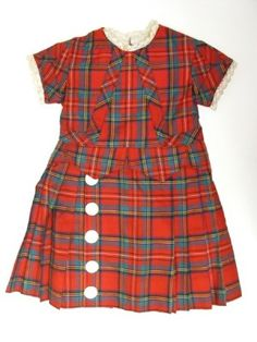 1873 Boy's Dress Culture: English Medium: wool, cotton, pearl Twilled wool, woven in green, blue, black and yellow tartan on red ground. Bodice lined with white twilled cotton. High round piped neck. Front in one section, back in one section each side of CB opening fastening with seven hooks and eyes. Short sleeves in one section, edges piped. Front trimmed bias strip from neck to each side of waist, continuing along waist to side seam. Similar trimming on sleeves.