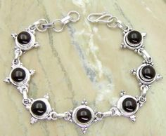 11.20ctw Genuine Garnet & .925 Sterling Silver Plated Brass Bracelet (SJHB0011GCAB) #silverbracelets #braceletsilver #braceletdesigns #sterlingsilverbracelets #silverbraceletsforwomen #braceletsformen #sterlingsilvercharmbracelet #bracelet #personalizedbracelets #gemstonebracelets #handmadebracelets #silvercharmbracelet Buy Now: http://www.sterlingsilverjewelry.tv/genuine-garnet-silver-plated-brass-link-bracelet-sjhb0011gcab.html